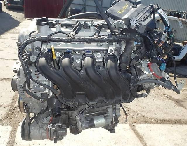 Демонтированный двигатель 2NZ FE