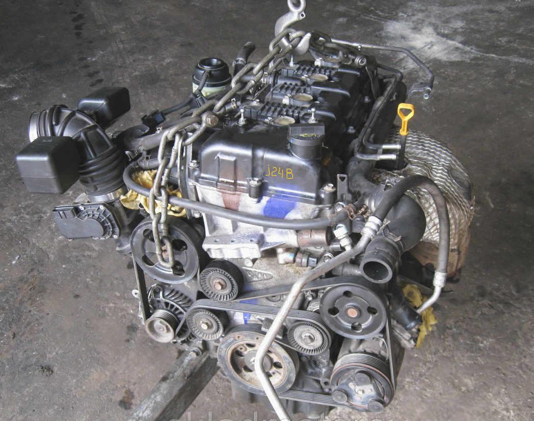 Демонтированный двигатель J24B